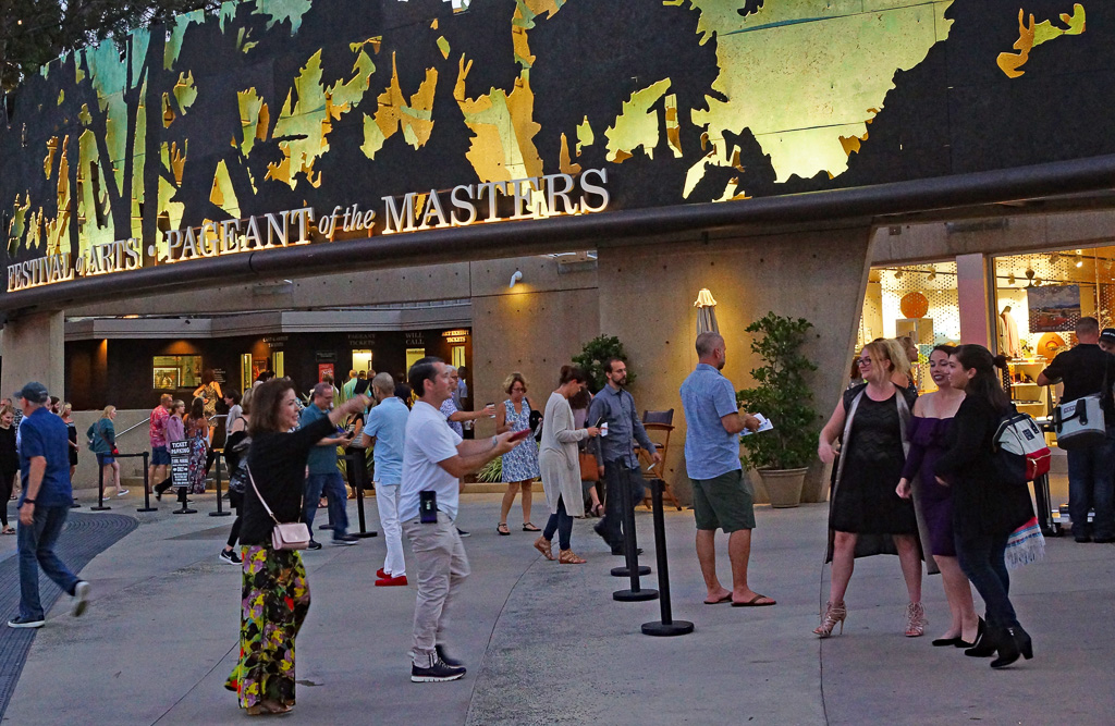 Pageant-goers pose for pictures before entering the Laguna Beach Festival of Arts grounds, where they can visit artists' booths, dine, sip wine or purchase souvenirs prior to the 8:30 p.m. Pageant of the Masters show. The festival is a summer art show, open daily, which runs alongside the nightly pageant. Photo: Fred Swegles