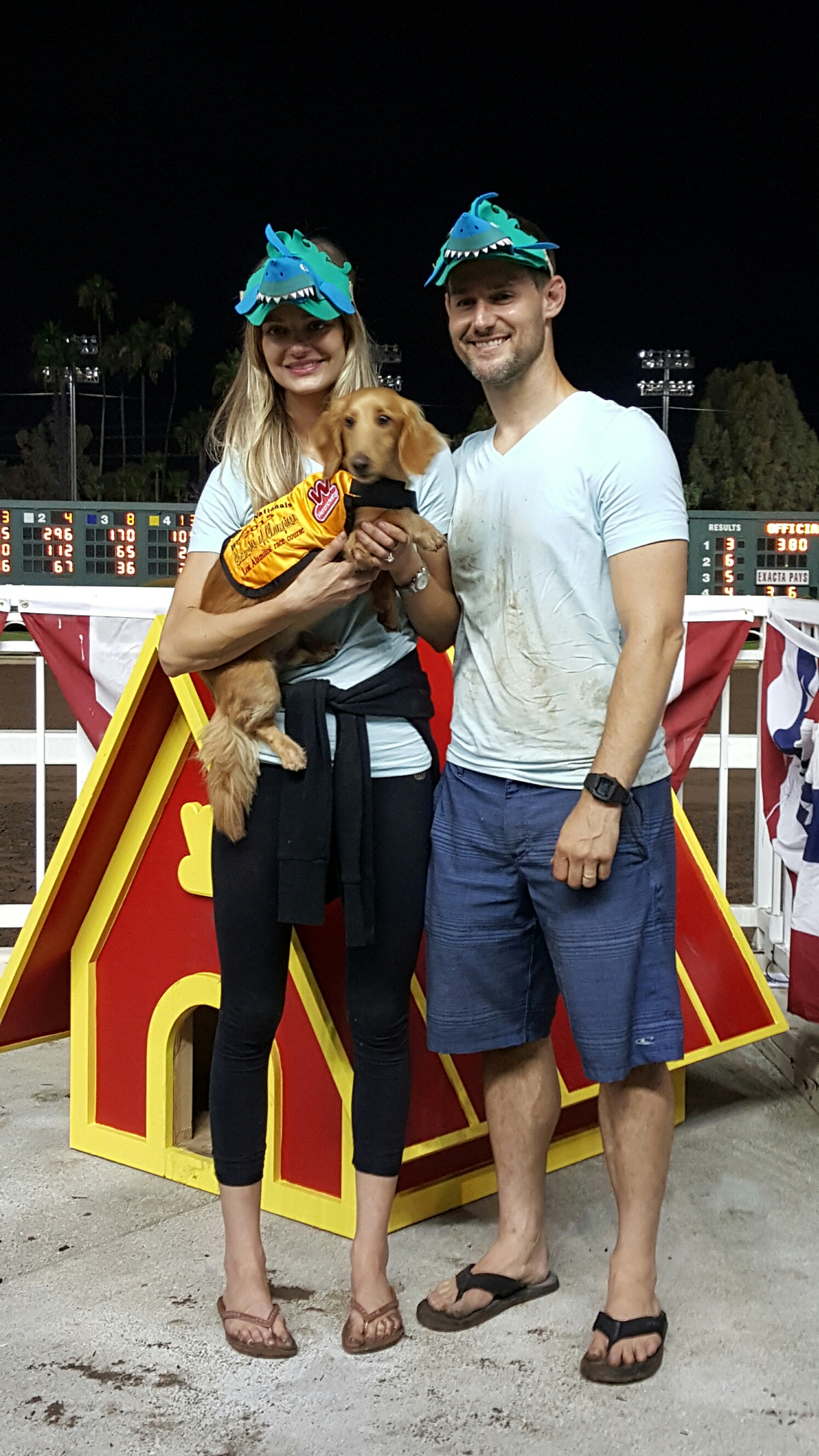 Finn's parents, Josh and Brittany Snook, wear shirts and hats of support as they cheer on Finn in the Wienerschnitzel Weiner Nationals race at Los Alamitos Race Course. Photo: Courtesy