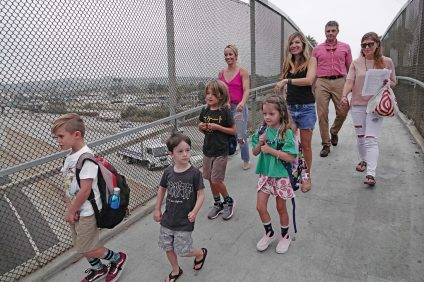 As commuters drove to work on Interstate 5, San Clemente students and parents were a step high above them, plying a pedestrian overpass to Concordia Elementary School on the first day of school, Tuesday, Aug. 21. Photo: Fred Swegles