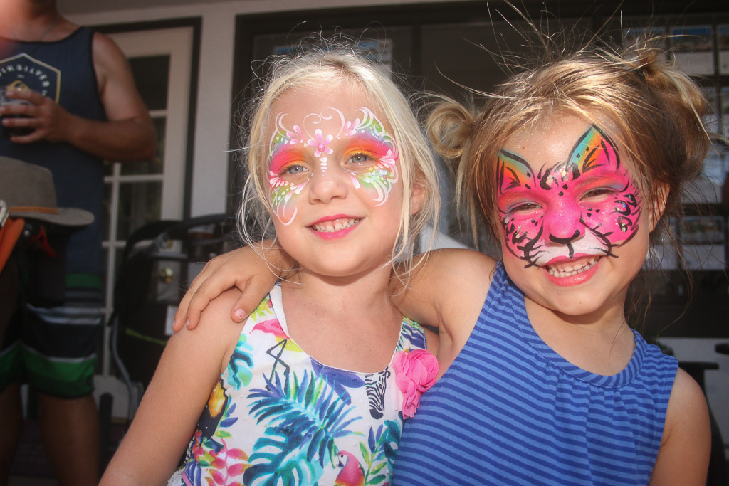 Two young girls show off their face paint on Aug. 12 on Avenida Del Mar during the San Clemente Fiesta Music Festival.