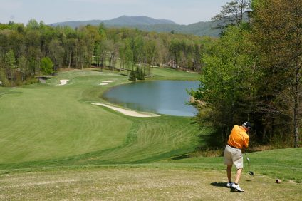 Nick Karnazes tees off in 2009 at Stoney Creek resort in Virginia, en route to completing 108 rounds of golf in 96 days across 48 states. Photo: Fred Swegles