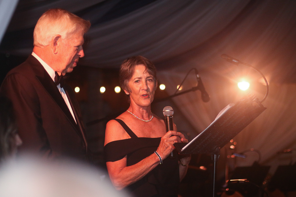 Peter Ochs, left, listens to his wife, Gail, speak as they were introduced to the audience as the honorary chairpersons of the 16th annual Toast to the Casa on Saturday, Sept. 22. Photo: Eric Heinz