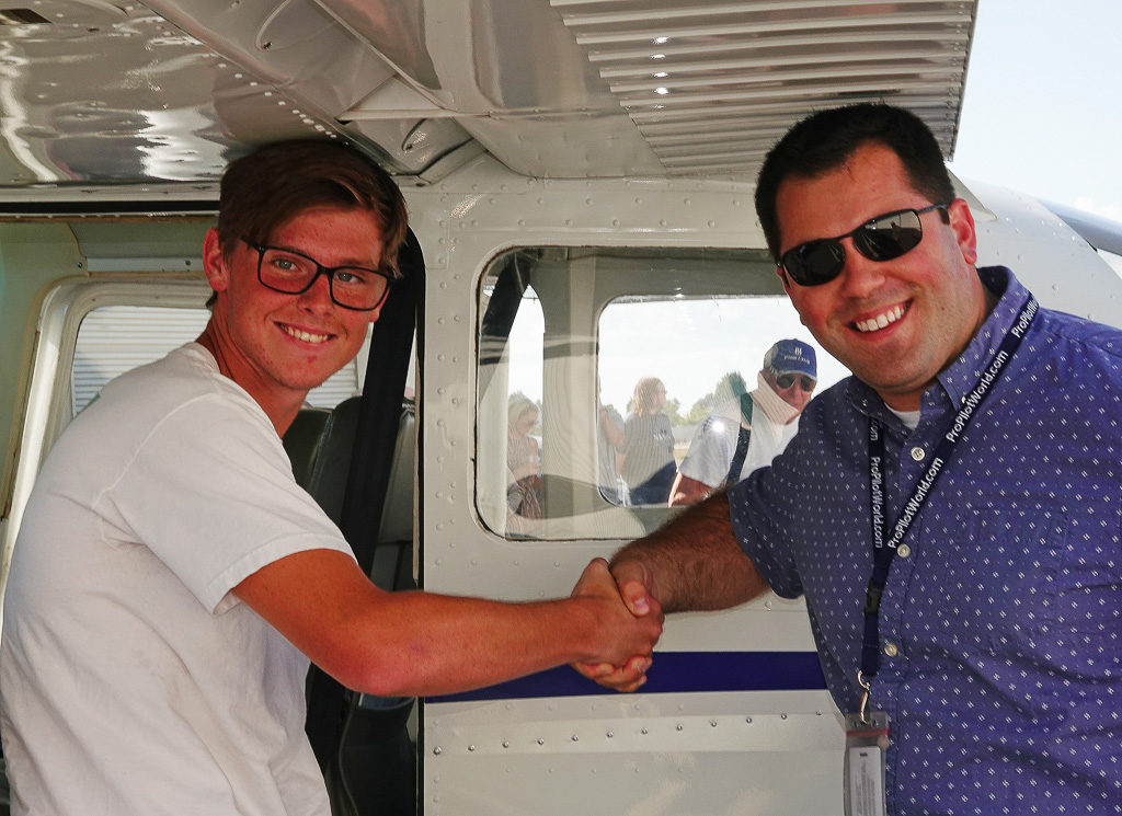 Flight instructor Jason Herman, right, congratulates solo pilot Patrick Economy, 16. They have been working together for a year and a half. Photo: Fred Swegles