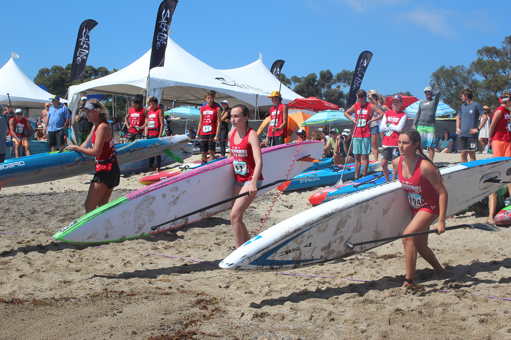 Competitors at last year's Pacific Paddle Games cross the finish line on the sands of Doheny State Beach. Photo: File/Daniel Ritz