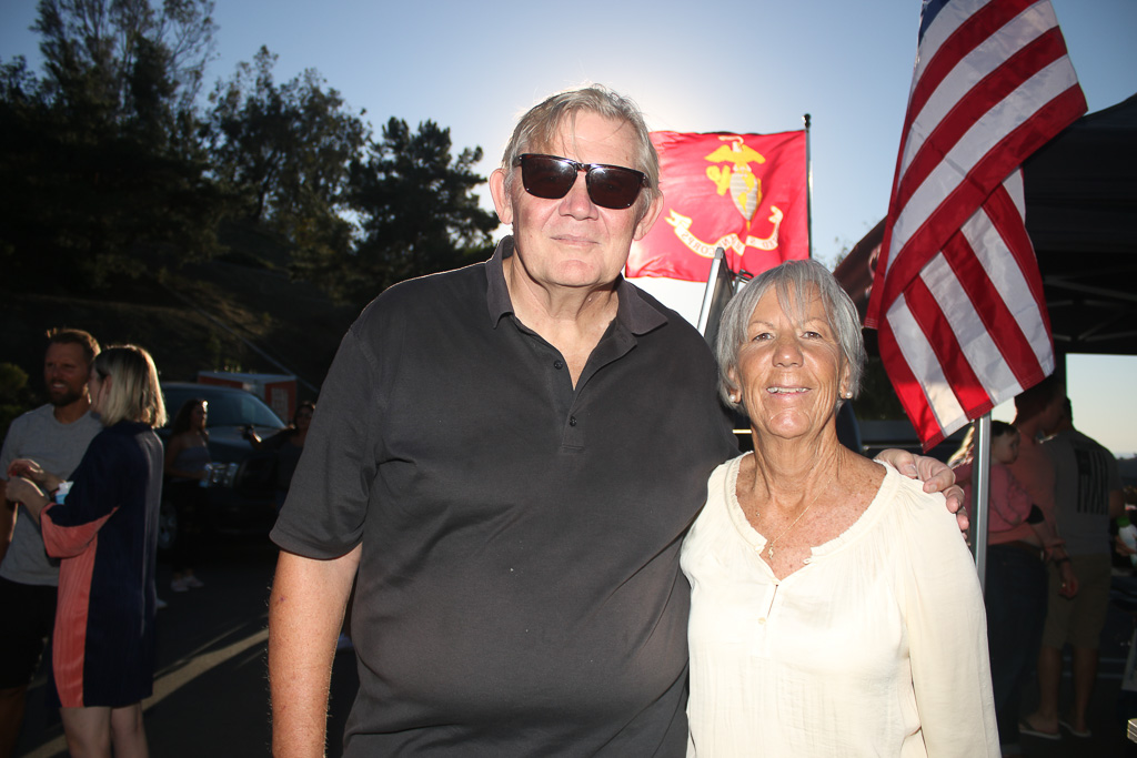 Jim and Carla Hogan pose for a photo during the Socks for Heroes event on Oct. 19 at Stance Socks in San Clemente. Photo: Eric Heinz