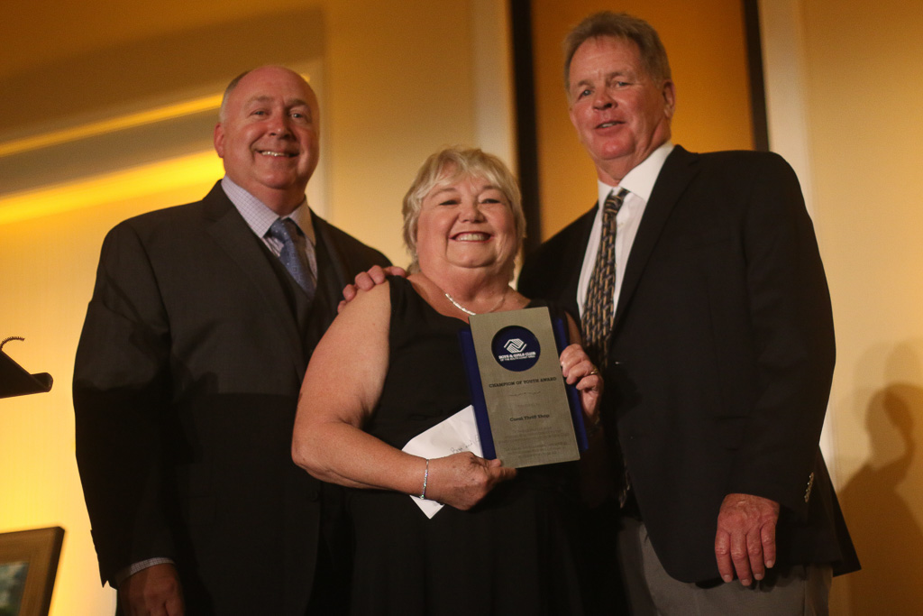 Sandy Murray, center, of Coral Thrift Shop is presented with a Champion of Youth Award with former BGCSCA chief executive Kent Campbell, right, and Terry Hughes, current CEO, at the Great Futures Gala on Oct. 20. Photo: Eric Heinz