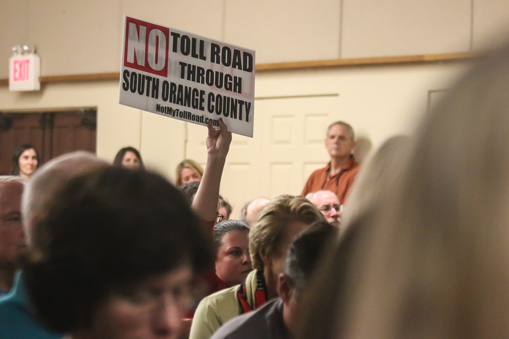 """""""No Toll Road Through San Clemente"""" or """"South Orange County"""" signs were prevalent at the Toll Road Town Hall hosted by the city of San Clemente on Oct. 24. Photo: Eric Heinz"""