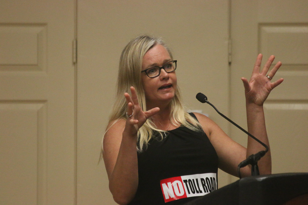 Michelle Schumacher, who has fought against the toll roads through San Clemente, speaks during the public comment portion of the Toll Road Town Hall on Oct. 24. Photo: Eric Heinz