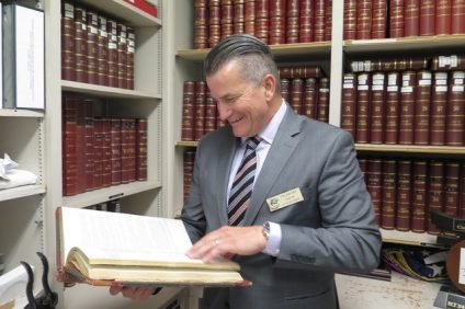 San Clemente Mayor Tim Brown examines documents stored by the San Clemente Historical Society. Photo: Tom Marshall