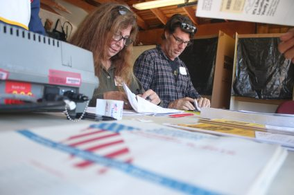 Volunteers assist voters in line at the polls on the 200 block of Esplanade in San Clemente on Tuesday, Nov. 6. Photo: Eric Heinz