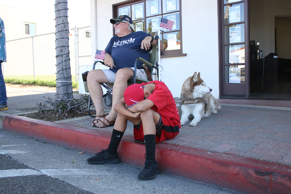 Rick Janovick, left, a Vietnam War veteran, and P.J. Janovicl, wait for the parade of Marines to start on Friday, Nov. 9, on Avenida Del Mar.