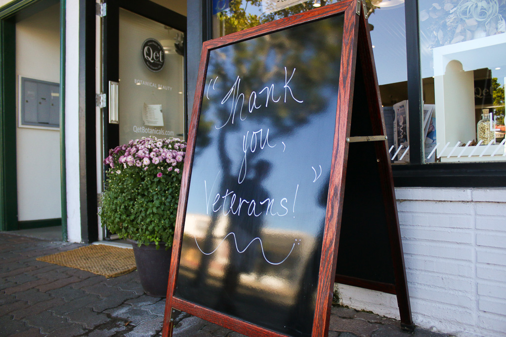 "A sign that reads ""Thank You, Veterans"" outside a shop on Avenida Del Mar. Photo: Eric Heinz"