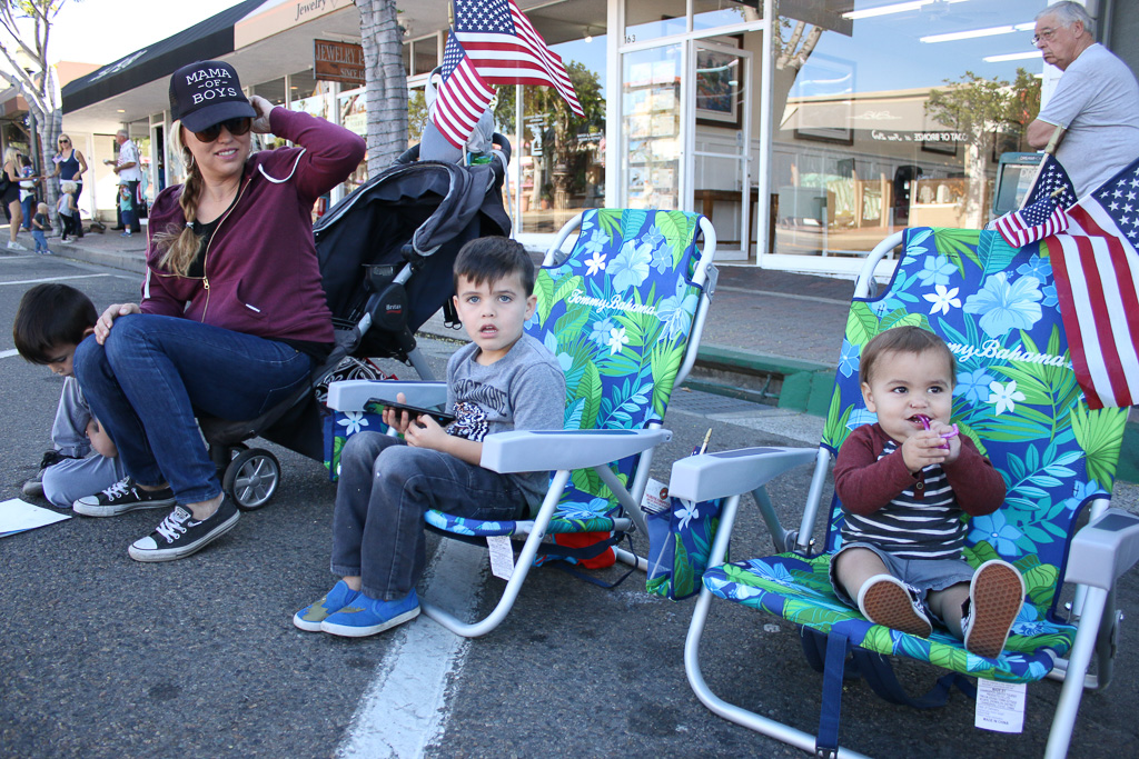 From left, Lindsey Gabaldon and her sons, Grant and Luke, await the parade of 2nd Battalion, 4th Marines on Nov. 9 on Avenida Del Mar. Photo: Eric Heinz