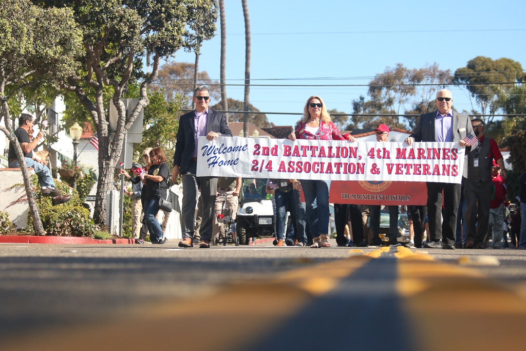 From left, Mayor Tim Brown and Councilmembers Kathy Ward and Steve Swartz lead the parade for the 2nd Battalion, 4th Marines on Nov. 9 on Avenida Del Mar. Photo: Eric Heinz