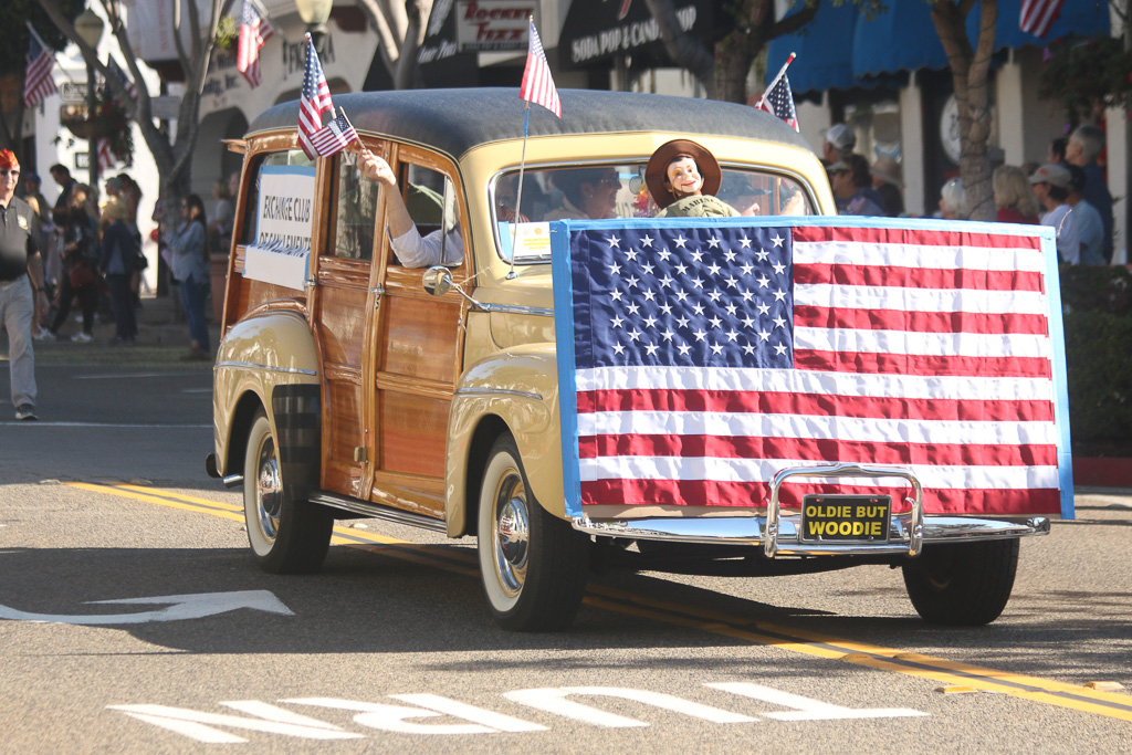 Woodie cars and others led the parade before the 2nd Battalion, 4th Marines walked down Avenida Del Mar on Friday, Nov. 9. Photo: Eric Heinz