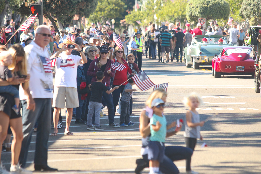 Parade attendees cheer for the returning 2nd Battalion, 4th Marines on Friday, Nov. 9, on Avenida Del Mar. Photo: Eric Heinz