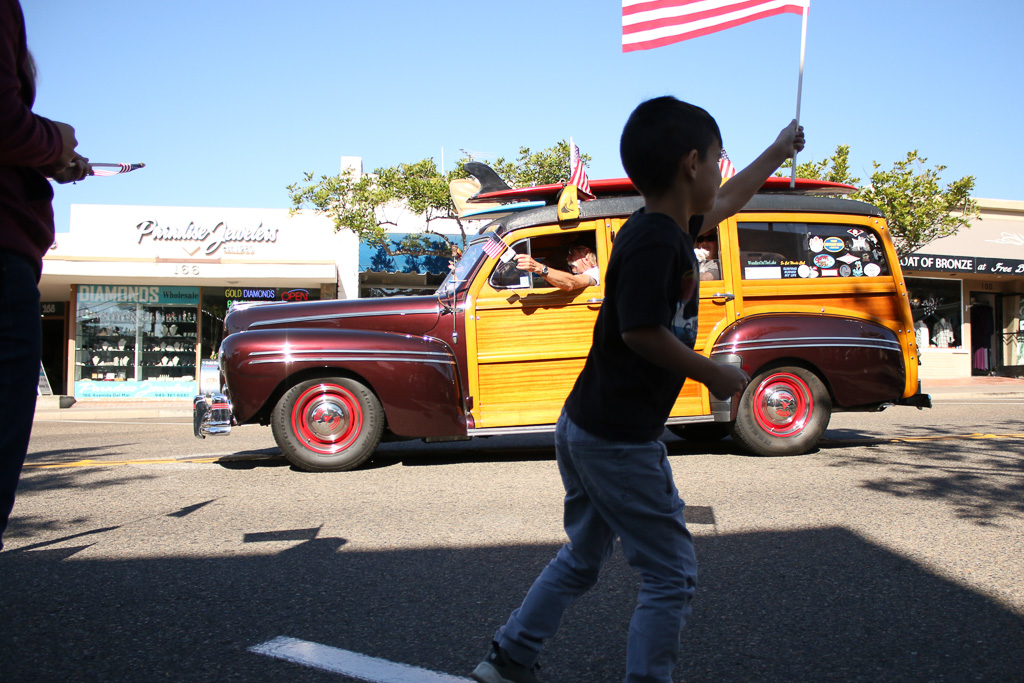 Woodie cars led the parade before the 2nd Battalion, 4th Marines walked down Avenida Del Mar on Friday, Nov. 9. Photo: Eric Heinz