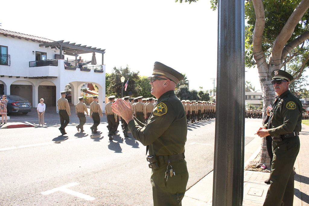 San Clemente Police Chief Lt. Mike Peters applauds the return of the 2nd Battalion, 4th Marines on Nov. 9 on Avenida Del Mar. Photo: Eric Heinz