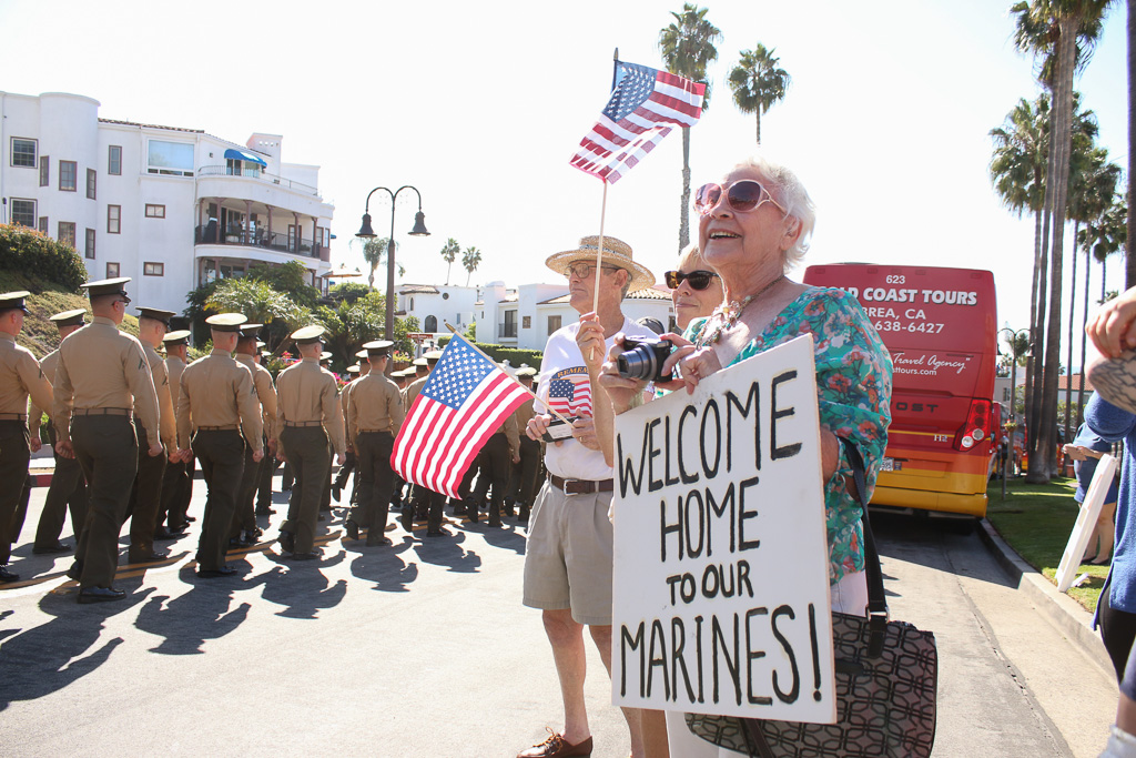 Margaret Jaszlics, far right, holds a sign welcoming the 2nd Battalion, 4th Marines back to the United States. Photo: Eric Heinz