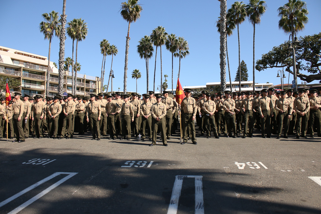 The 2nd Battalion, 4th Marines stand at-attention at the conclusion of a parade welcoming them back from Australia. Photo: Eric Heinz