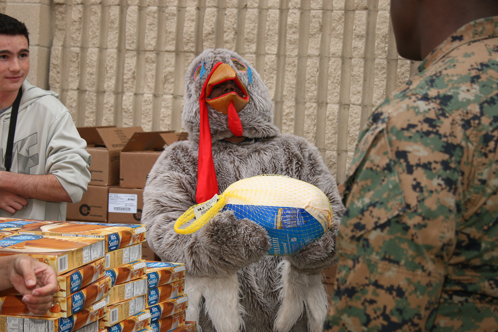 A turkey mascot laments for his frozen friend during the distribution of Thanksgiving dinners on Monday, Nov. 19, at Camp Pendleton. Photo: Eric Heinz