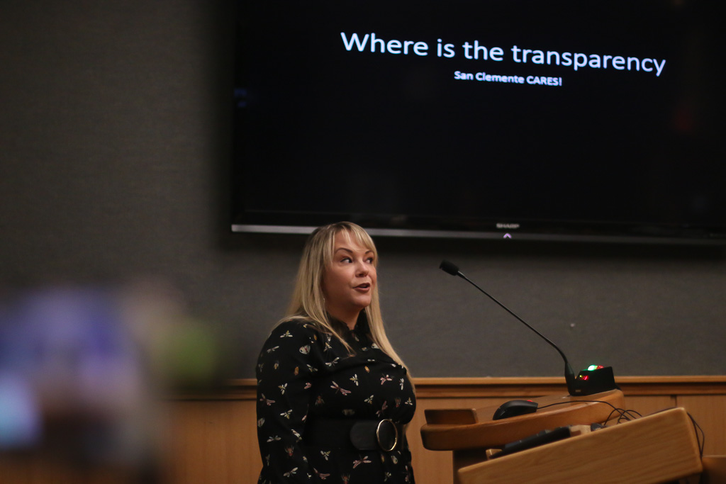 Multiple speakers with slideshow presentations explained their reasons for wanting adjustments to the city manager's contract on Tuesday, Nov. 20. Photo: Eric Heinz