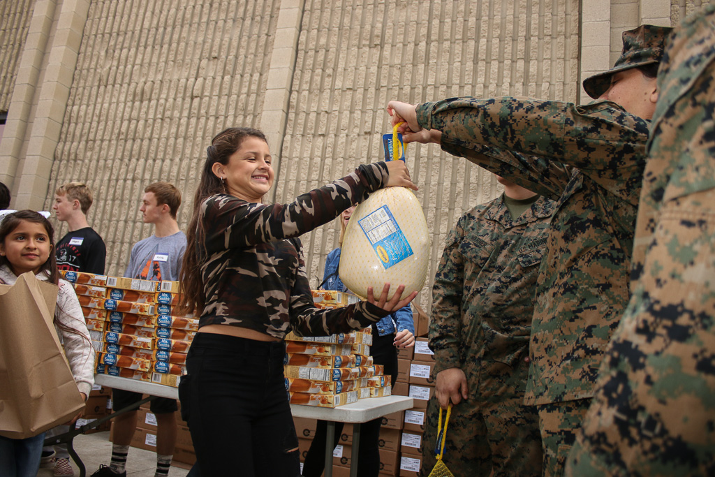 Marines stationed at Camp Pendleton helped with the distribution of turkeys and Thanksgiving sides on Monday, Nov. 19, during an annual event hosted by San Clemente Military Family Outreach. Photo: Eric Heinz