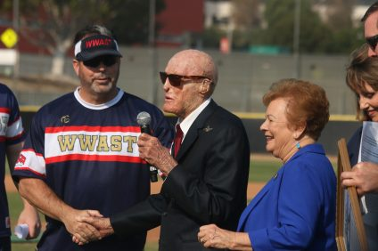 San Clemente resident and WWII veteran Col. Robert Thacker, center, was honored for his 100th birthday before the Wounded Warrior Amputee Softball Team game on Saturday, Nov. 10, at Saddleback College.