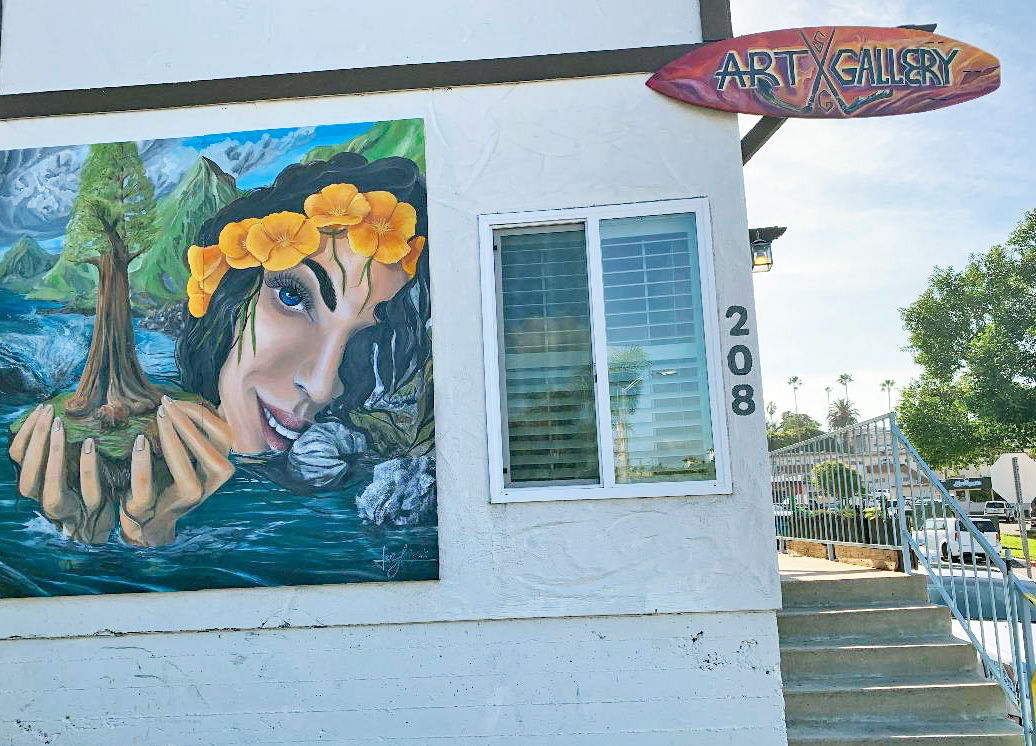 San Clemente artist Jeff Lukasik brightens up the Los Molinos industrial district with this mural on the wall of his building.