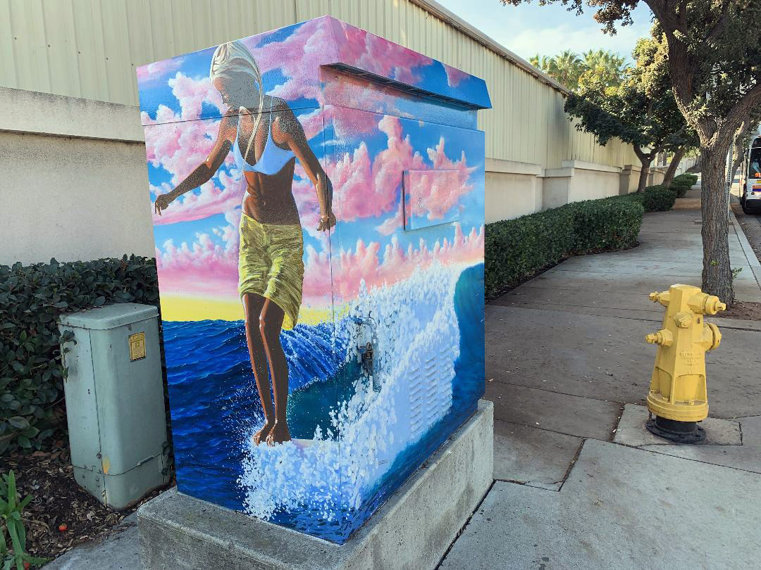 "Artist James Parkhurst, titled ""Water Dance,"" on Avenida Pico at Calle de los Molinos as part of a city campaign to decorate traffic signal control boxes. Photo: Fred Swegles"