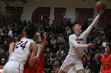 San Clemente boys basketball will be fighting for every inch down the stretch of the season as the Tritons look to crack the league's top three and make the playoffs. Photo: Eric Heinz