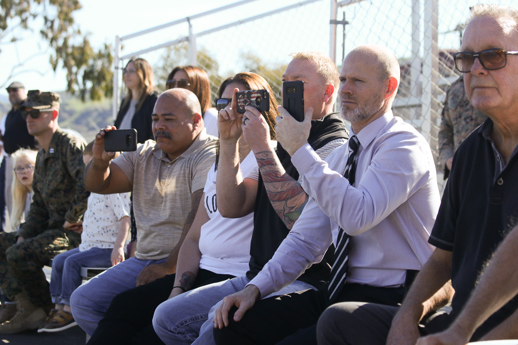 Spectators record the change of command ceremony on Friday, Jan. 25 at Camp Pendleton. Photo: Eric Heinz