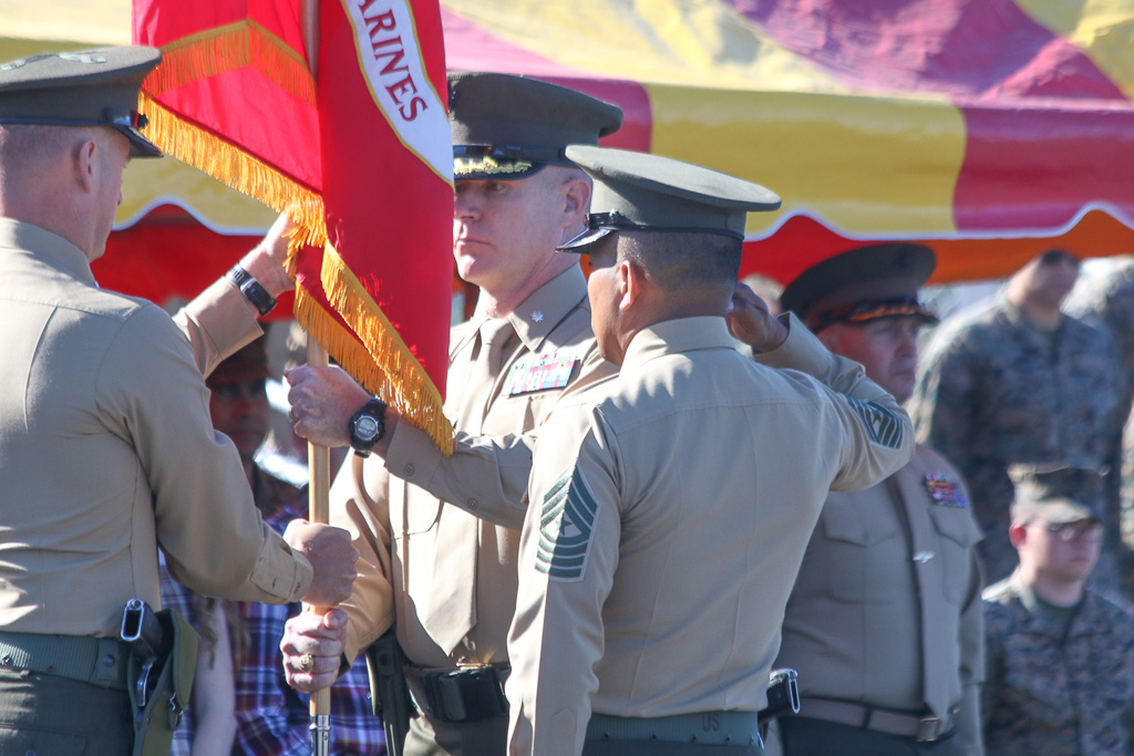 Lt. Col. Patrick Byrne receives a Marine Corps flag as he accepts command of the 2/4 on Friday, Jan. 25, at Camp Pendleton. Photo: Eric Heinz