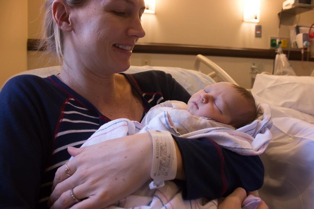 Megan Kroeger holds her newborn child, James Austin Kroeger, on Jan. 3 at MemorialCare Saddleback Medical Center in Laguna Hills. Photo: Eric Heinz