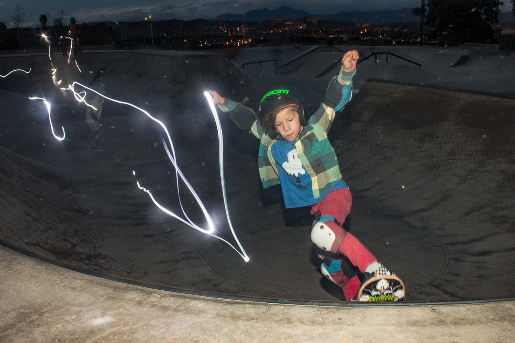 Jude Sager, 6, skateboards with a light in a long-exposure photo on Sunday, Jan. 13 at the Ralphs Skate Court. Photo: Eric Heinz