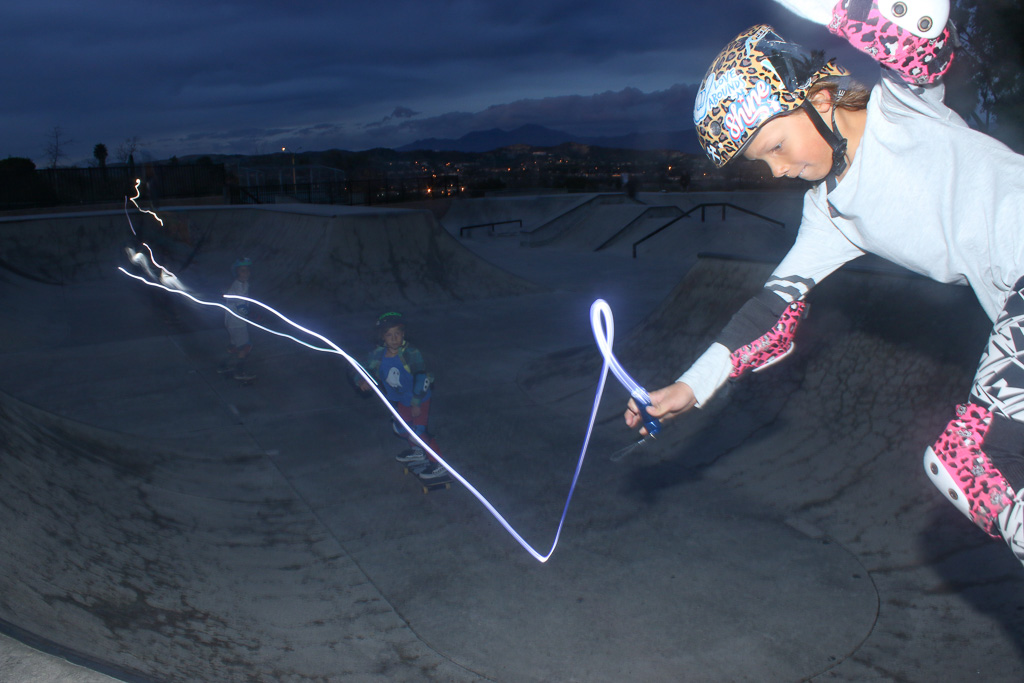 Happy Sager, 8, holds a flashlight during a long-exposure photo on Sunday, Jan. 13 at the Ralphs Skate Court in San Clemente. Photo: Eric Heinz