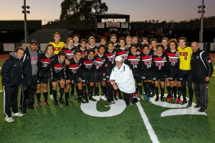 San Clemente boys soccer coach Mike Pronier (center in white) celebrated his 400th win as coach of the Tritons in a win over Dana Hills on Thursday, Jan. 3. Photo: Kreg Kowarsch
