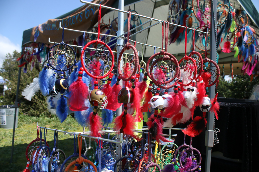 Dreamcatchers with NFL team logos were sold at a vendor's tent on Sunday, March 24, during Panhe.