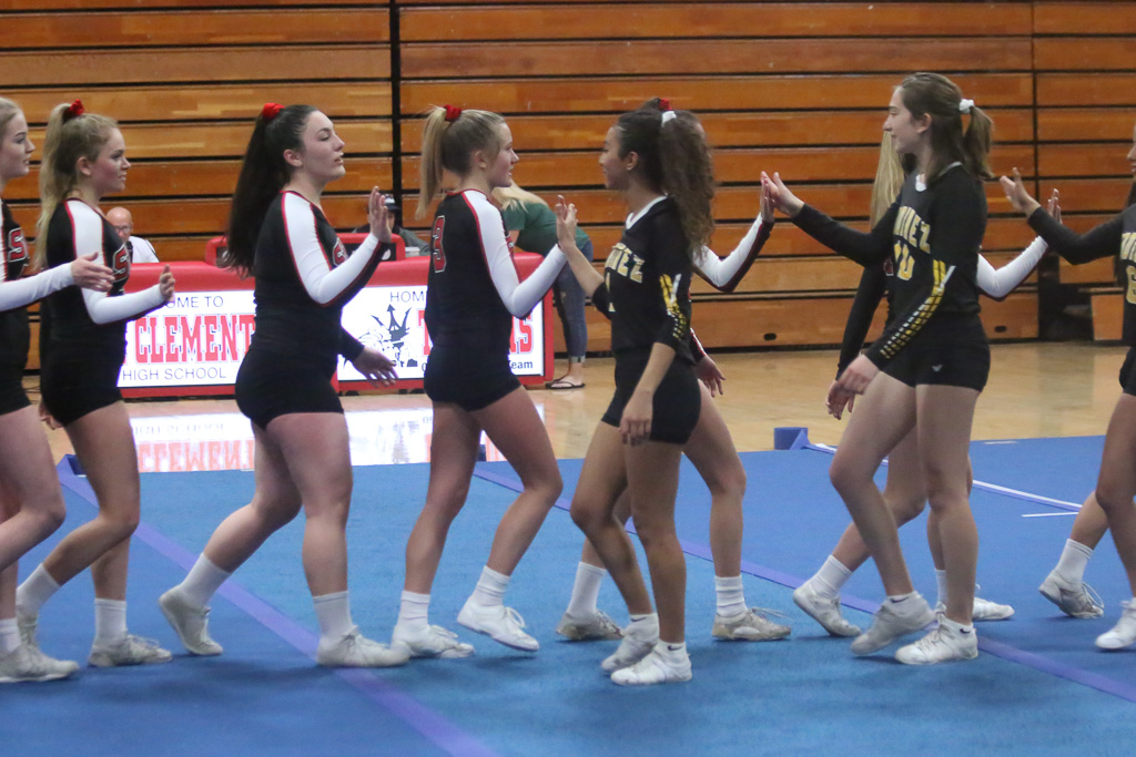 San Clemente is fielding competitive cheer teams for the first time this season. The Tritons are striving for awareness as a sport along with competing for wins and losses. Photo: Eric Heinz