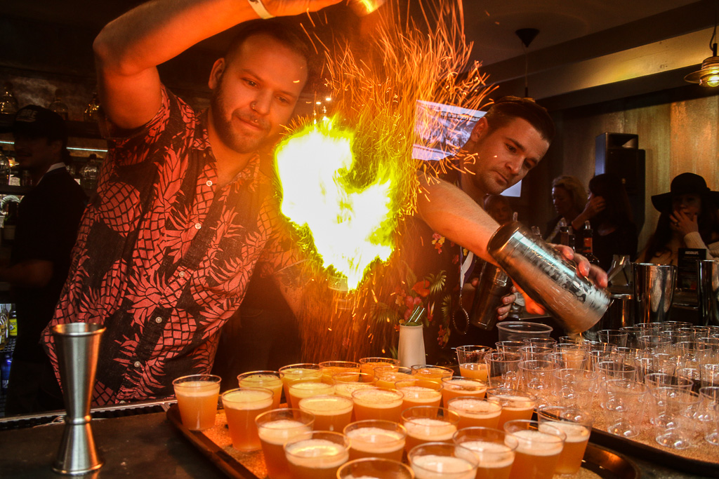 Bartenders perform as they mix drinks at last year's Mixologist Competition. This year's event takes place on Thursday, March 21, at H.H. Cotton's. Photo: File/Eric Heinz