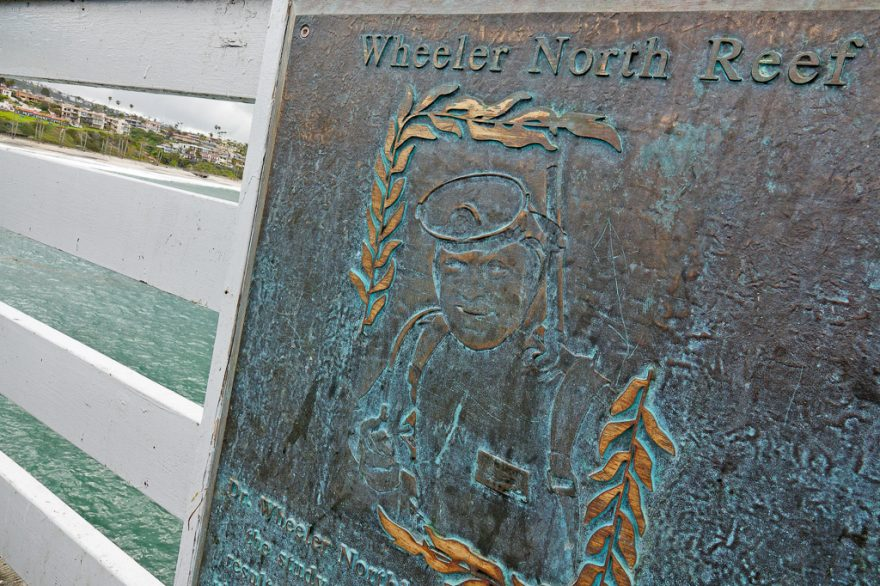 A plaque memorializing the work of Wheeler North and the reef that's named after him is located on the San Clemente Pier. Photo: Fred Swegles