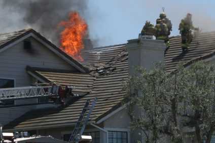 Firefighters battle a fire within a home on April 10 on the 800 block of Calle Vallarta in the Seaview Estates neighborhood. Photo: Eric Heinz