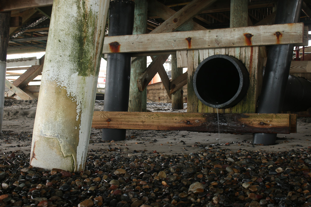 The large drainage pipe at the base of the Pier is where water samples have been taken. For the last four years, they've consistently registered unsafe levels of bacteria. Photo: Eric Heinz
