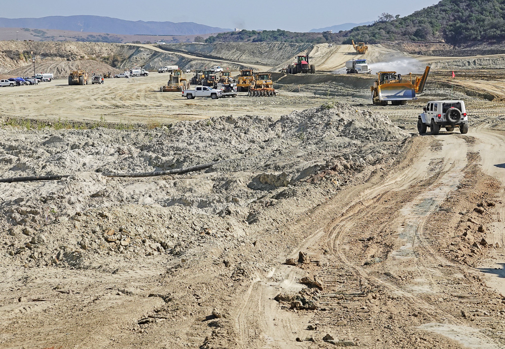 Santa Margarita Water District is moving 4.29 million cubic yards of earth, spread over 177 acres, to build Trampas Canyon Reservoir. Photo: Fred Swegles