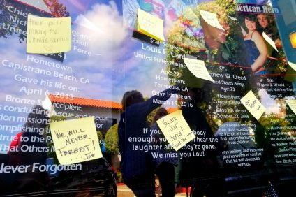 Post-it notes decorate a windowfront in downtown San Clemente Saturday to commemorate fallen American soldiers over the Memorial Day weekend. Photo: Cari Hachmann