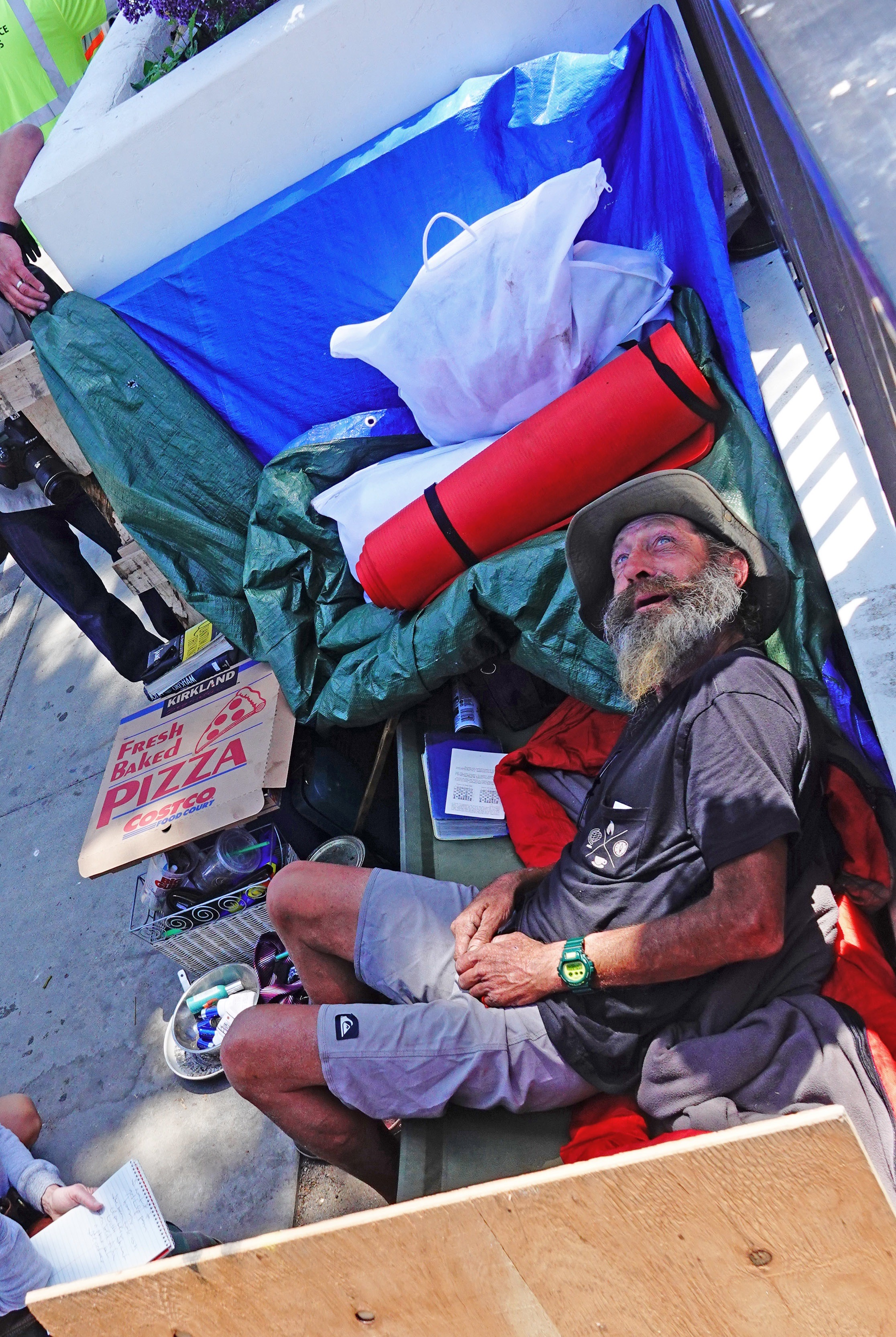 A camper identified as Duane takes a moment to relax while Sheriff's deputies endeavor to clear San Clemente's North Beach parking lot of an encampment on Friday, May 24. The city offered the campers an alternate location a short distance up Avenida Pico from the beach. Photo: Fred Swegles