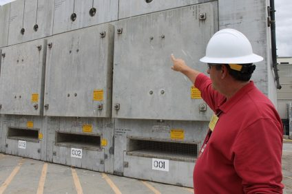 During a May 10 tour, SCE Media Relations Manager John Dobken points to dry storage facilities where spent nuclear fuel is housed at SONGS. Photo: Cari Hachmann