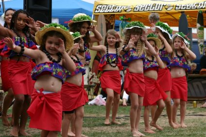 Polynesian dancers from all over Southern California will perform traditional dances in their native costumes accompanied by Polynesian music at the 29th Anniversary Polynesian Festival & Luau Feast on Saturday, May 25. Photo courtesy of The Hawaiian Surf Club of San Onofre.
