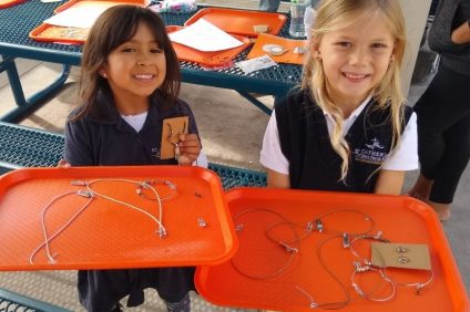 Little Villagers' students Cassandra and Sadie, donate their handmade jewelry for mothers of Families Forward nonprofit organization.
