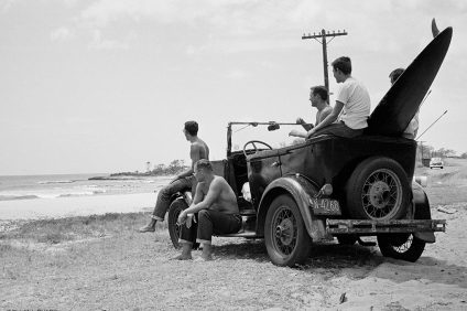 """Dick Metz, Al Weimers, Herb Nolan and a couple of locals survey the potential of Makaha on the west side of Oahu from Metz's Model A """"bathtub"""" jalopy circa 1954. Photo: Dick Metz Collection/SHACC."""
